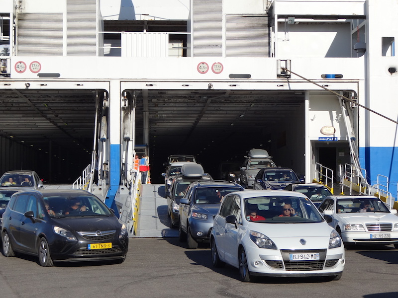 Cars unloading from ferry